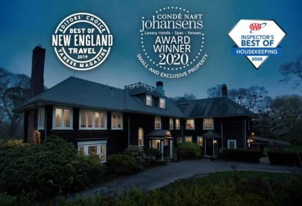 The exterior of the inn with various awards including Best of New England Travel from Yankee Magazine 2019, AAA Best of Housekeeping 2020, and Conde Nast Johansens Best Small & Exclusive Property 2020