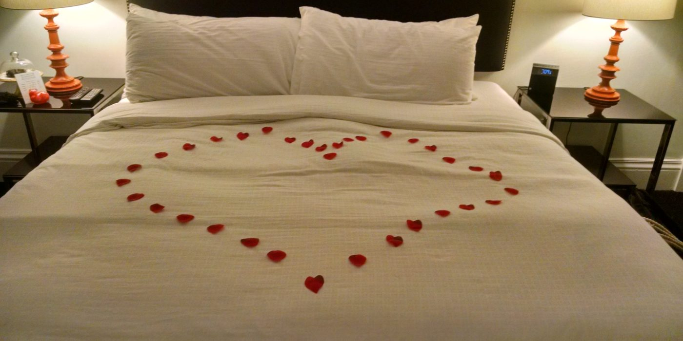Flowers In Heart Shape On Bed